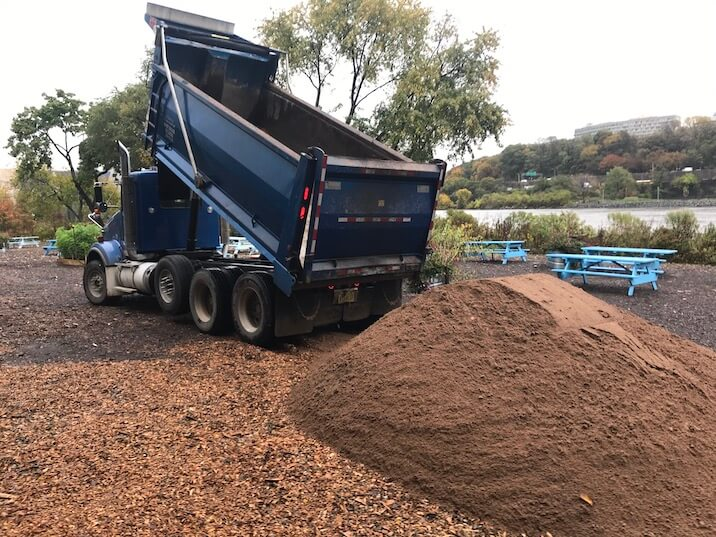 truck dumping compost